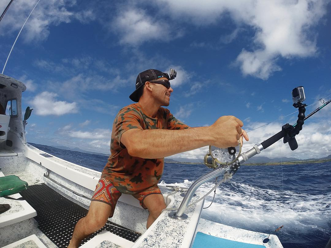 When he's not riding waves on the North Shore, you'll find @kamaleialexander keeping the #mana alive and reeling in a big ones. What's on the other end of his line?  #GoProFishing