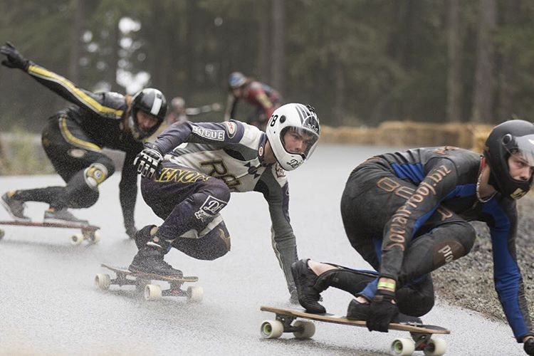 Team rider Spencer Smith hunts number one qualifier Charlie Darragh at the Whistler Longboard Festival. We will be back in the rain tomorrow. @equalmotion with the