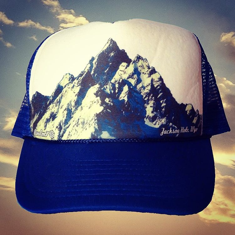The Majestic Blue trucker hat features a photo of the Gand Tetons by @robkingwill taken from an airplane descending into Jackson Hole.  Back in stock at www.avalon7.co  #avalon7 #liveactivated #truckerhat #snowboarding #jhlife #adventuremore