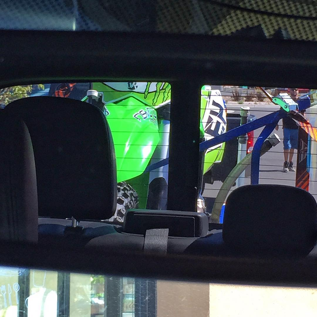 Very stoked to see this in my rear view for the next 4 hours of driving. Can't wait to ride that 450cc thing this evening! #Kawasaki #KX450f #FordRaptor #familydeserttrip