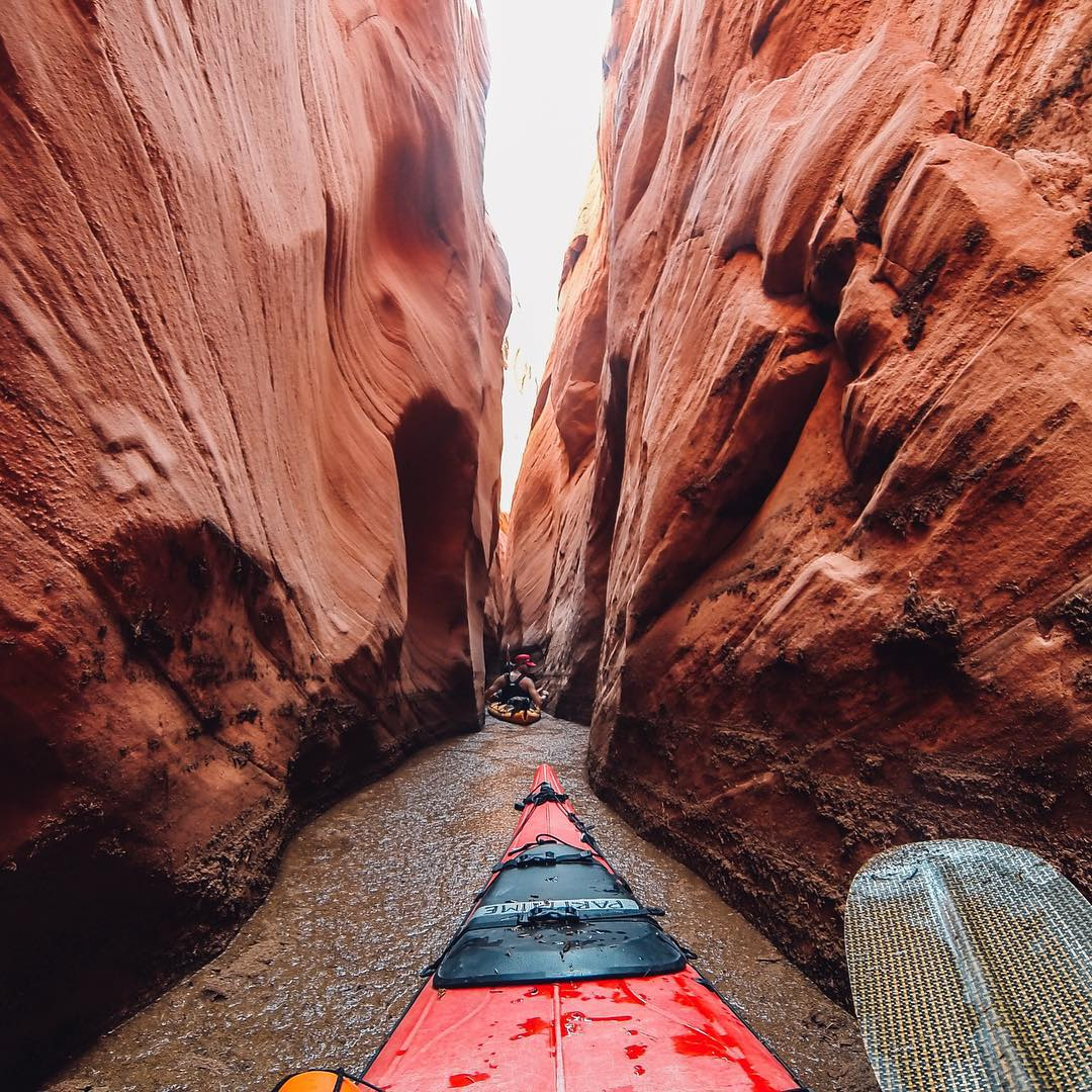 Photo of the Day!  @mtdrewporter navigates the tight confines of Labyrinth Canyon on Lake Powell. The water was covered with an eight-inch layer of debris, hence the brown color. Share your best moments with us at gopro.com/submit. #GoPro #kayak...