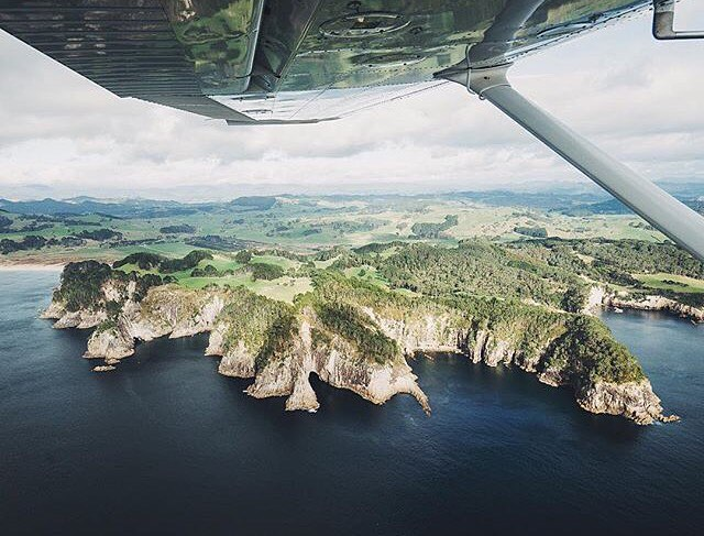 @lebackpacker's view under the left wing, looking at @thecoromandel in New Zealand. #
