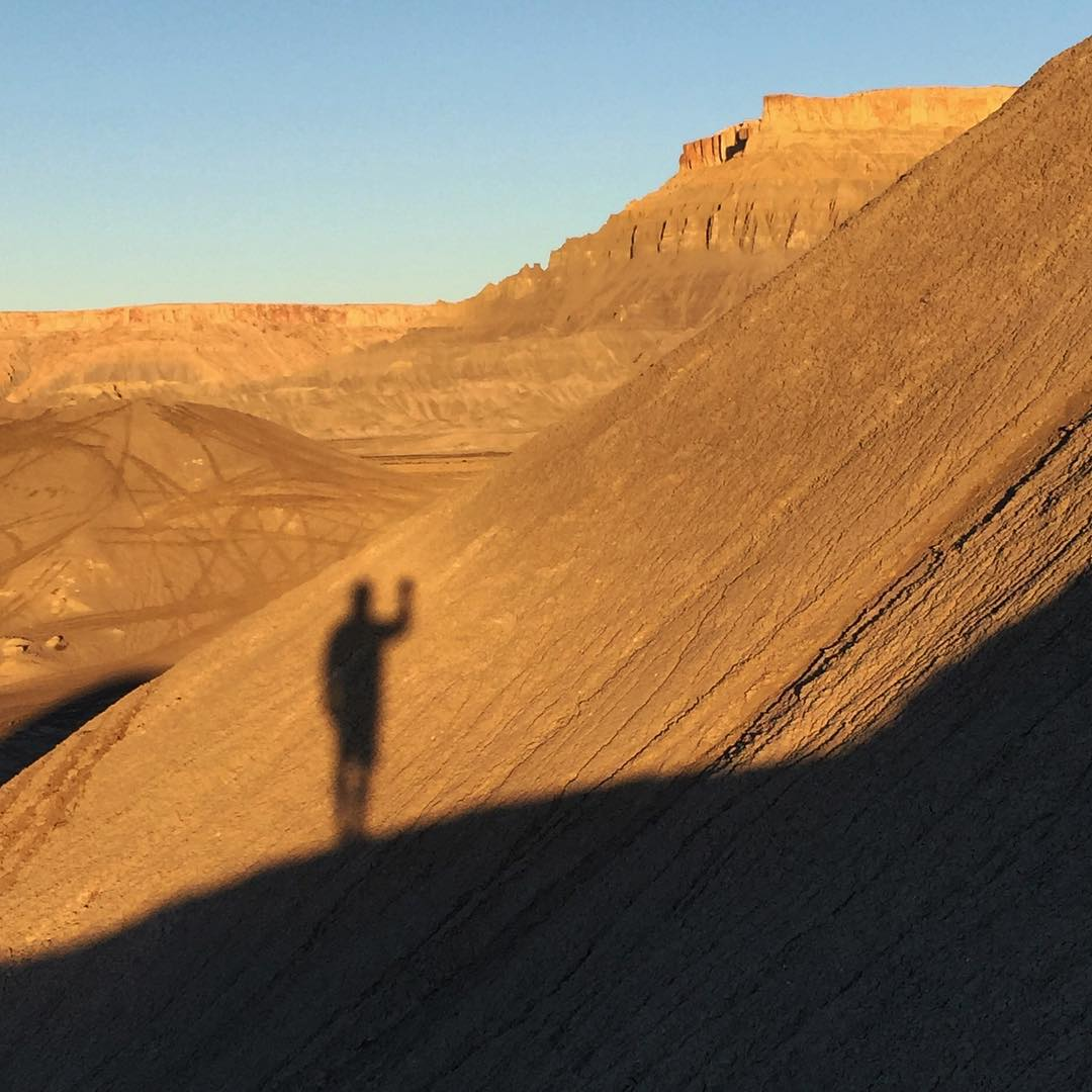 Morning desert shadow selfie. Swingarm City, UT. The sunrises here are 1000% worth waking up early for. #familyshredication