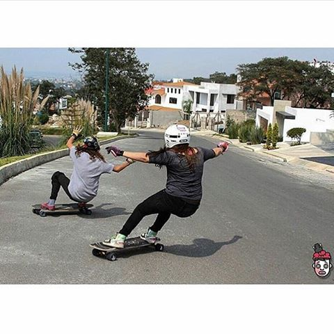 LGC Mexico riders @gogo_gc & @paolabarabash tandem sliding. Have a great weekend everyone!  Repost from @holesom. Photo @rubentrrs954.  #longboardgirlscrew #womensupportingwomen #skatelikeagirl #lgcmexico #mexico