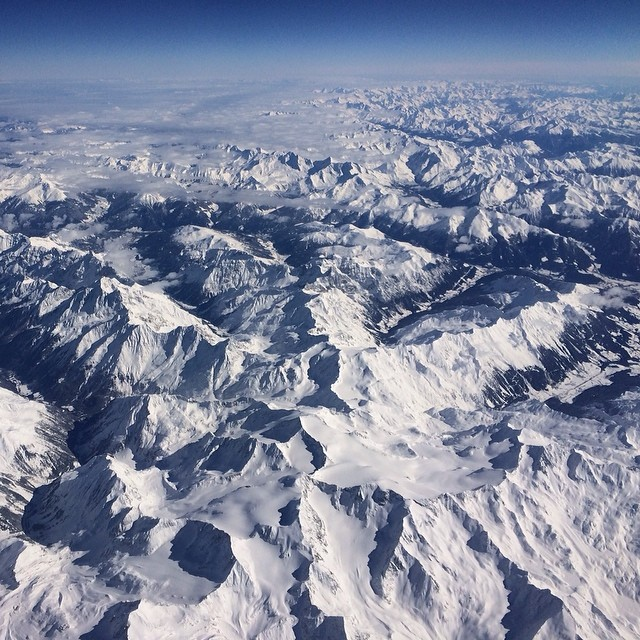Flying over the Alps isn't terrible... #kinddesign #liveyourdream #almosthome