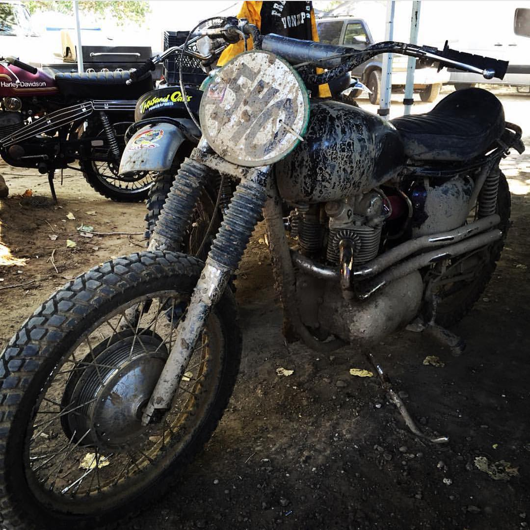 It's getting a bit muddy out at @milestonemx. The @hellonwheelsmc vintage takeover is complete with a mud pit that you're suggested to jump over...but where's the fun in that?