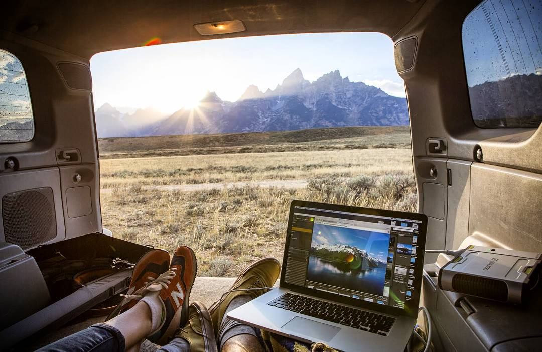 A little work, a big sunset and the Tetons. #officeanywhere  Photo: @jgboyer