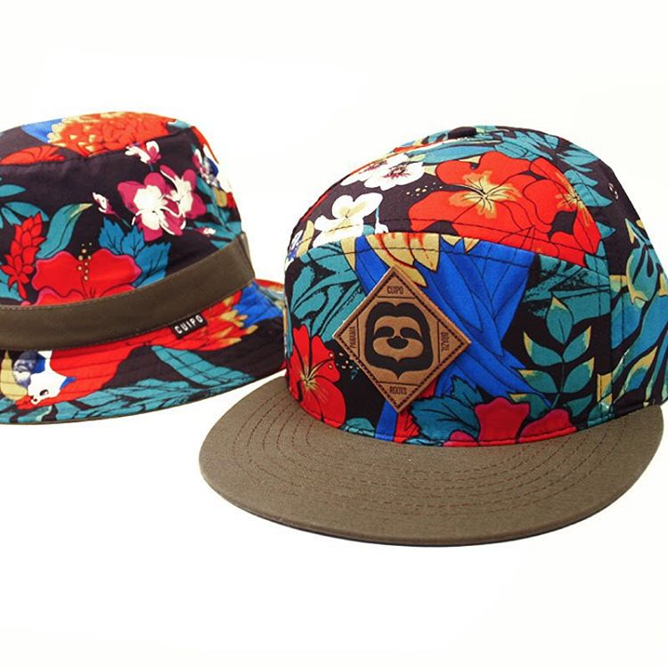 Summer might be over but you can wear our floral Macaw print #BucketHat and #CamperHat all year long. #Cuipo #SaveRainforest #CuipoRoots #HatsonHats