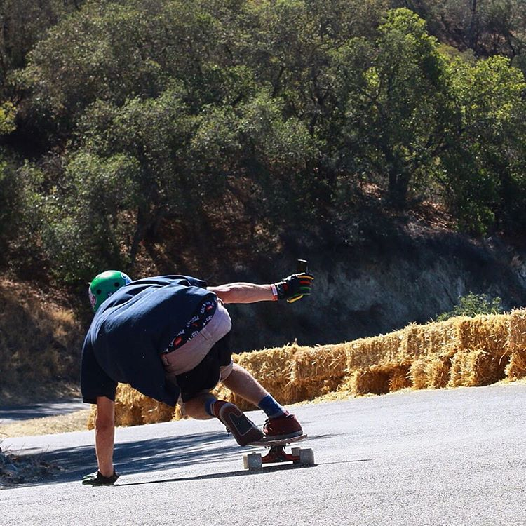 Dipping and diving, Schu (@ajschu) made an appearance at the #santagnarbaradownhill. He's all about having a good time on a skateboard and it clearly shows everytime he's riding. Sick photo courtesy of @jakegroove.