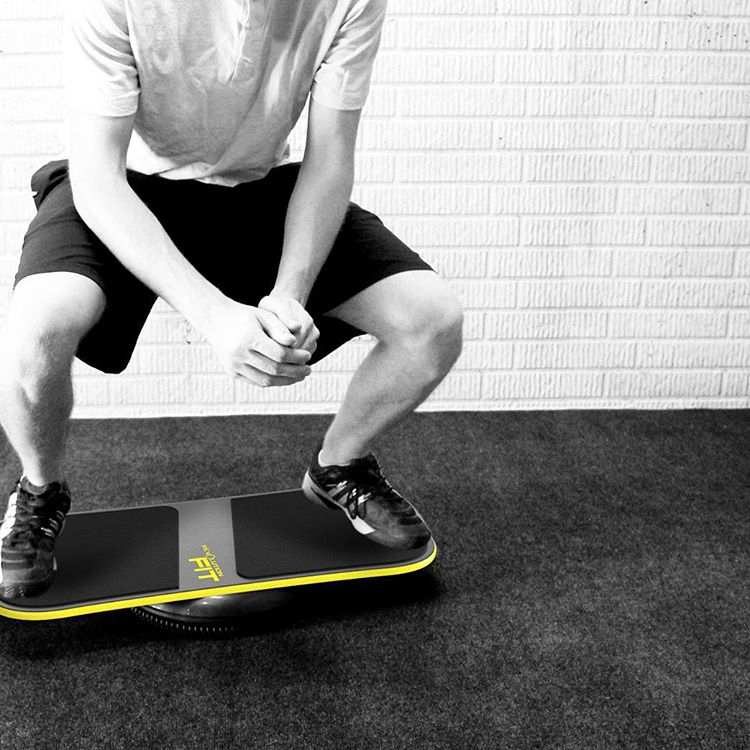 Squats on the #fitboard! #revbalance #findyourbalance #balanceboards #madeinusa