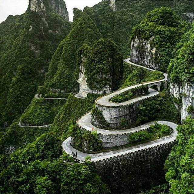 SKATE IT!  Roads in China are serious business.  Tianmen National Park. Repost from @ourlonelyplanet. Vladimir Popov photo.  #roadporn #longboardgirlscrew #china ##skatelikeagirl #lgc #womensupportingwomen