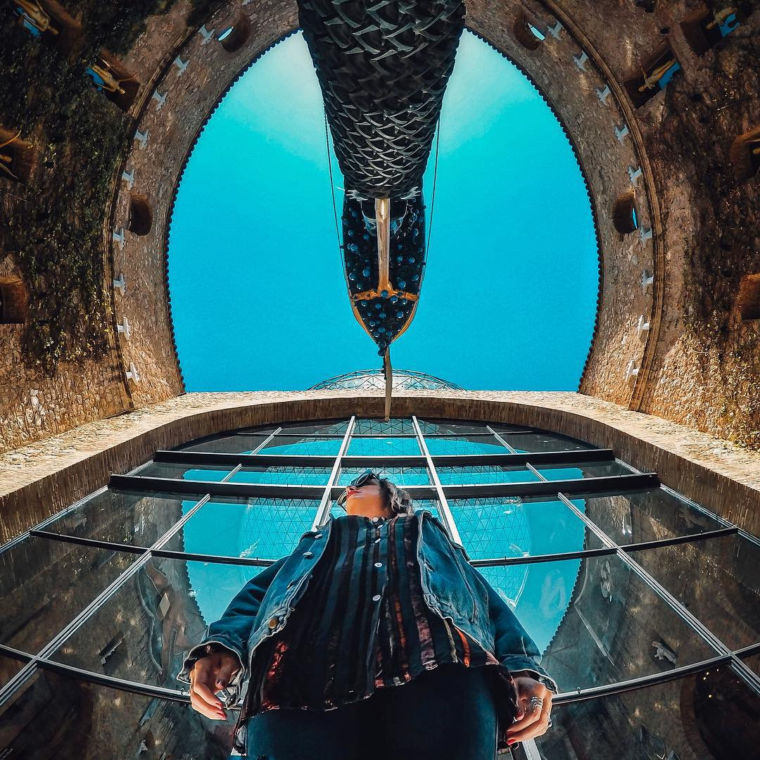 Photo of the Day!  @j.sopelski snapped this shot of his girlfriend @tara_montenegro while capturing the unique geometry of the @dalimuseum in Spain. Share your best travel moments with us by clicking the link in our profile. #GoProTravel