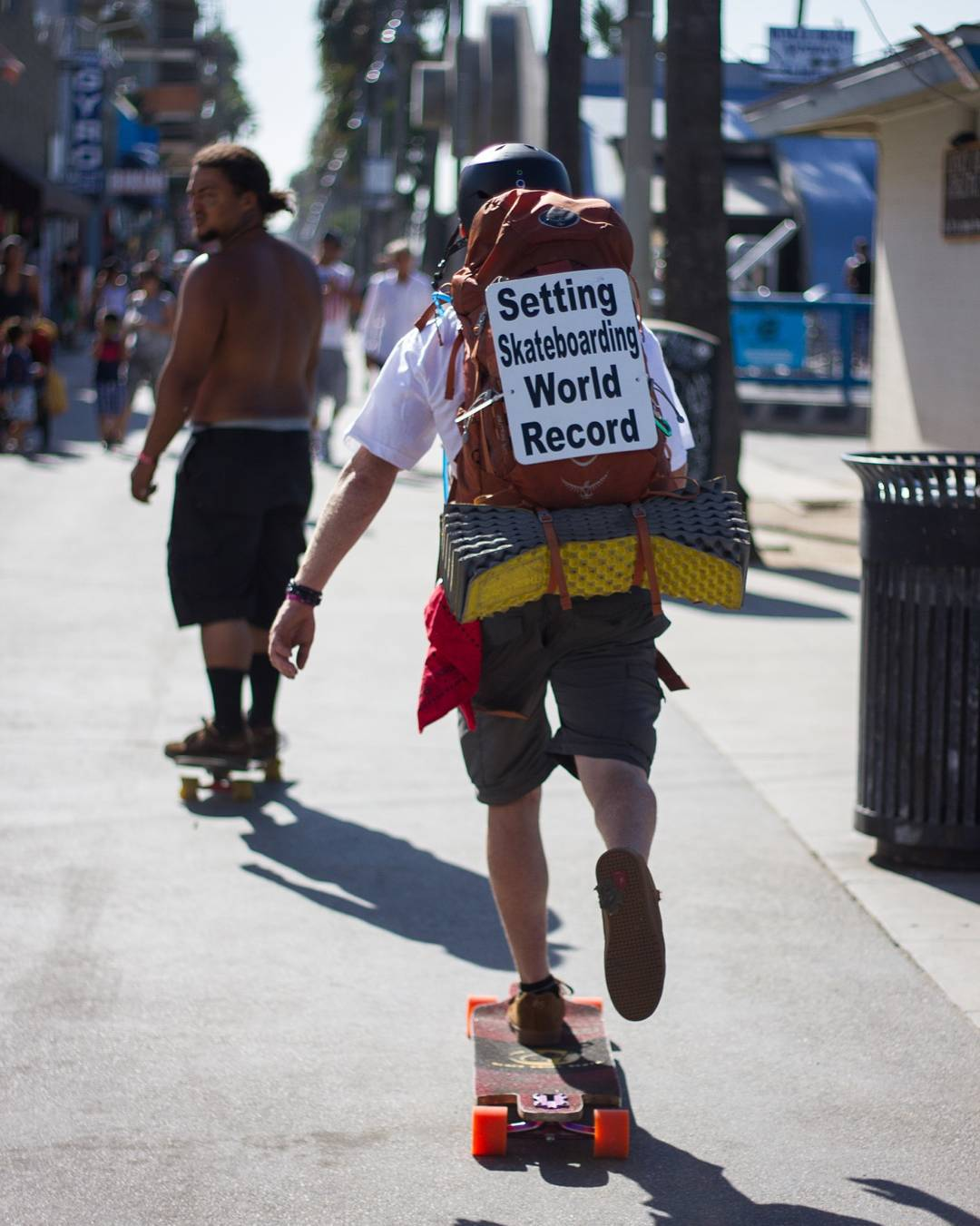 If you see this sign attached to the back pack of a red headed man, that would be @wyattwelter.  A man with a mission, Wyatt is breaking the world record for longest distance pushed on a skateboard. When he came through LA, he had already covered 3,541...