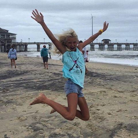 Sun + Sand + Surf = team rider @tybeeanna jumping for joy! #luvsurf #luvsurfgirl #team #sun #sand #surf