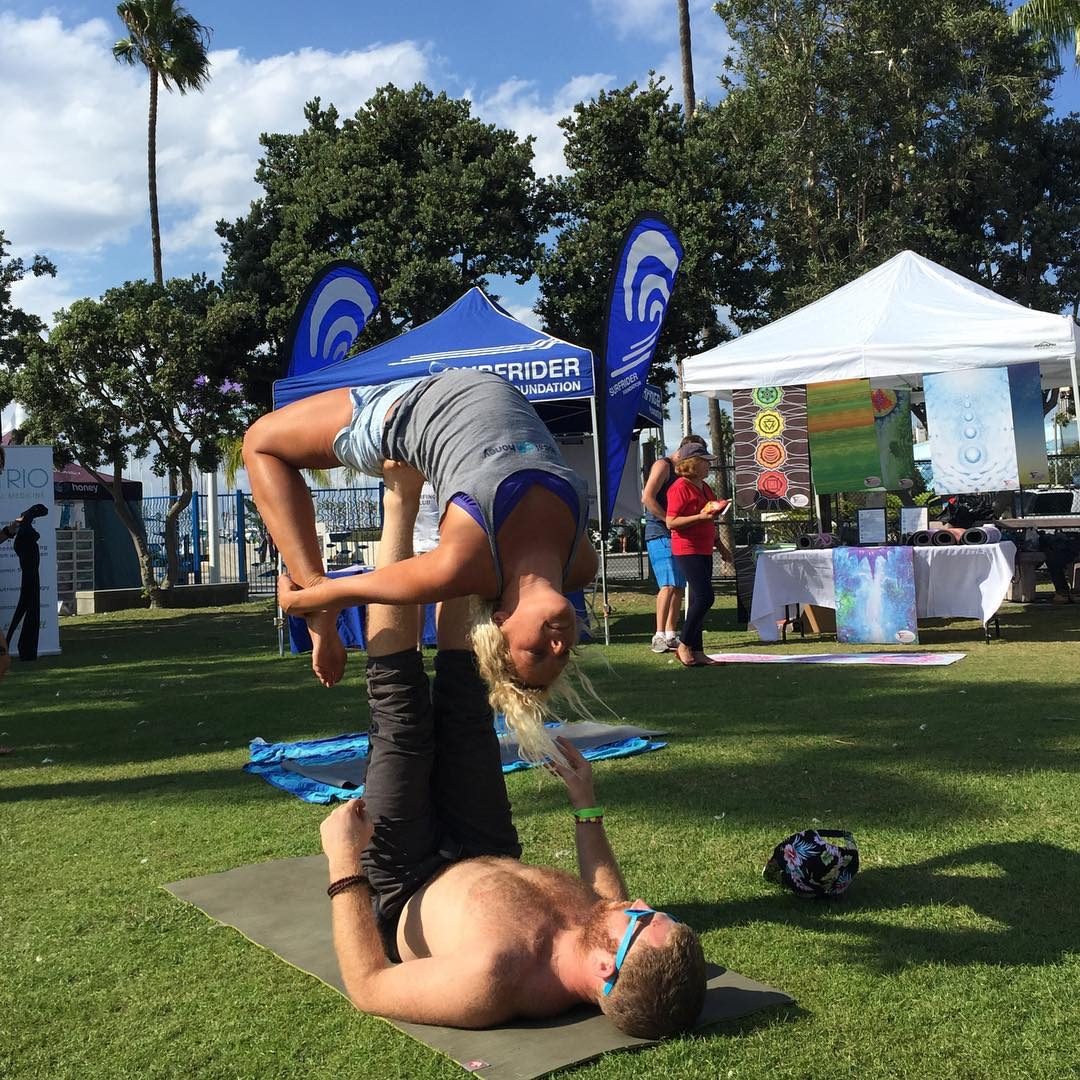 @andymay23 getting her feet wet with some Acro Yoga the @beyondtheshoreorg festival in Redondo Beach!