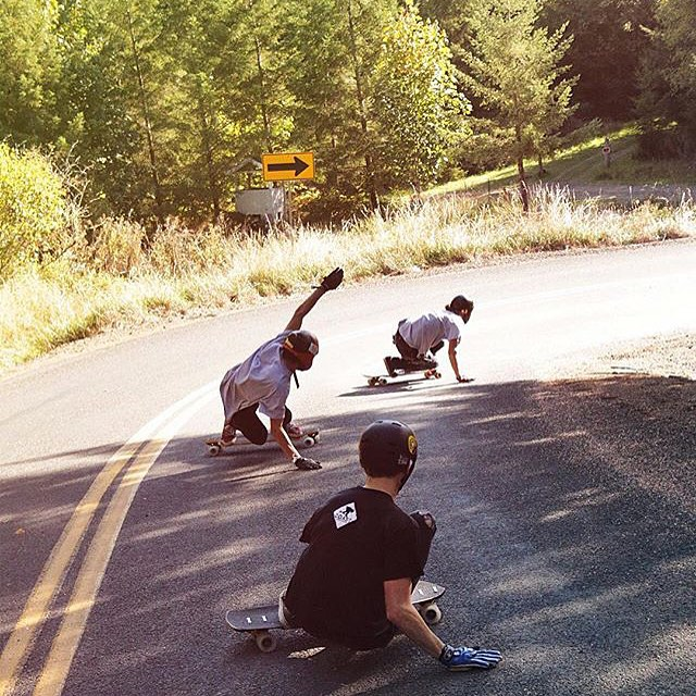 Charging down this chundery run, Morgan Owens (@_morganowens_ncmb) leads the crew, demonstrating the inside line while riding #crucibles on a road paved with chip seal. Photo:@samgalus  #divinewheelco #divinewheels