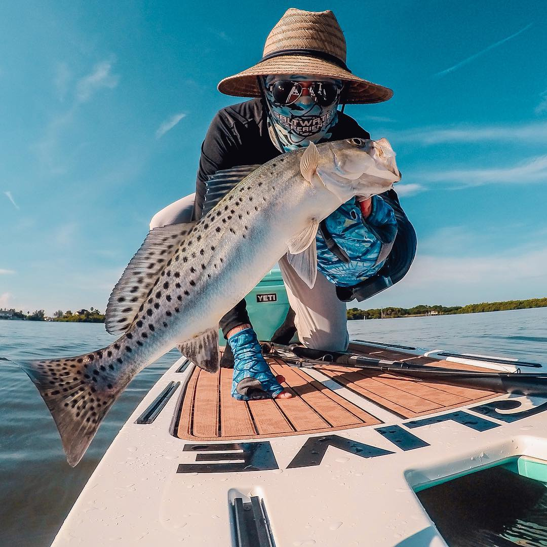 Photo of the Day!  No case of the Monday's for @phild_hughes after reeling in a speckled sea trout from his paddle board while fishing the Indian River in Florida. Share your best catches with us by following the link in our profile. #GoProFishing