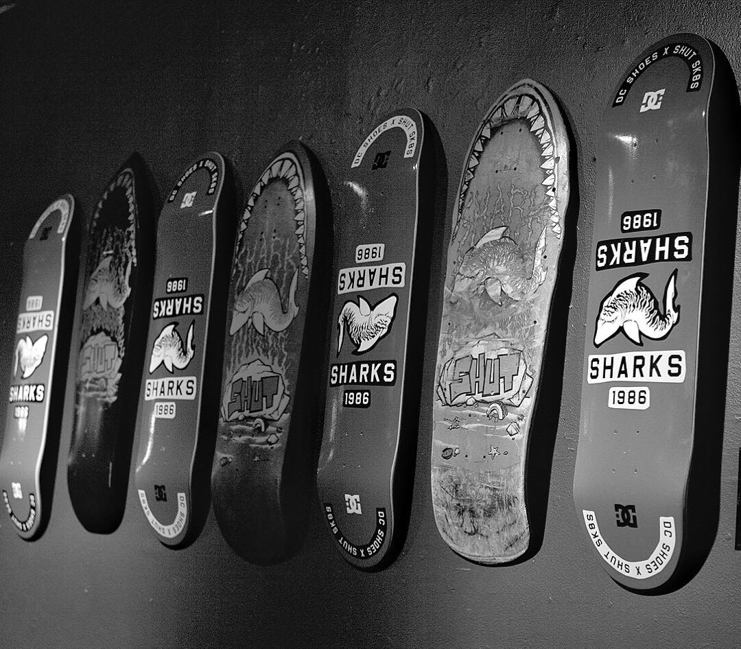 "New #DCxSHUT collab decks along with some vintage @shutnyc ""Sharks"" decks on the walls of @maxfishbar in NYC. Photo: @blabacphoto #DCShoes"