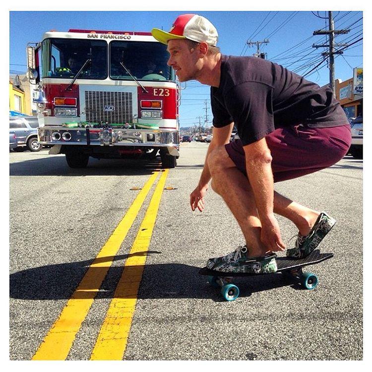 @antonymfilms cruising past Engine #23 (SF fire dept.) on a @bureo board with a fresh pair of camo #PrahuBoatShoe