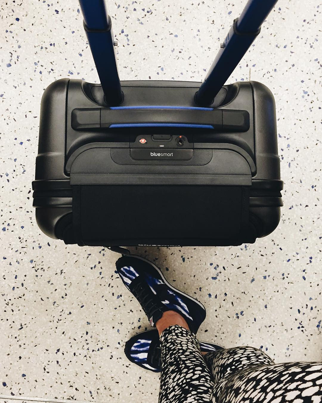 Slip-on kicks and a Bluetooth powered @bluesmart suitcase. Try beating that combo.
