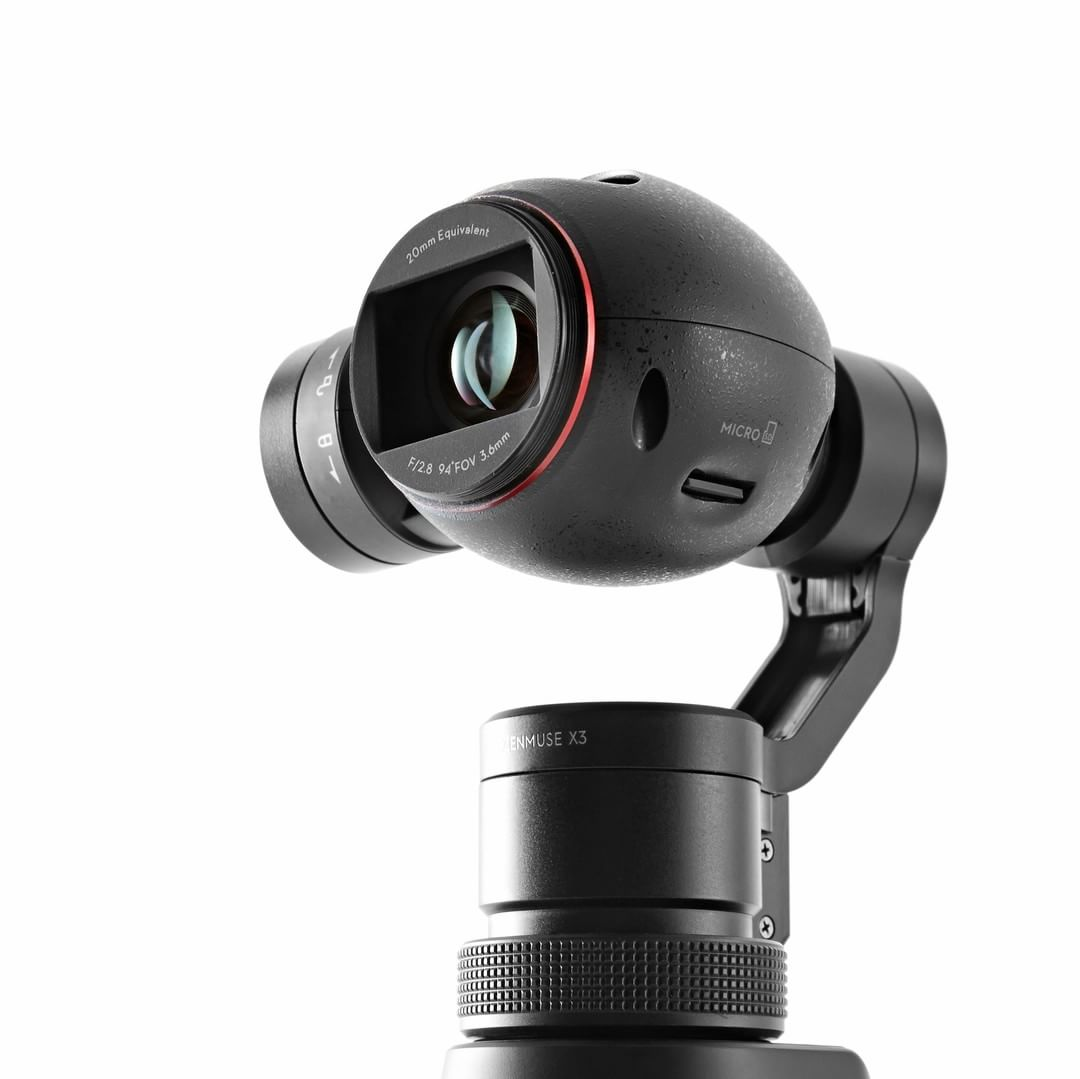 It's finally here. The #DJI #OSMO.  Using the siganture Zenmuse 3-axis gimbal technology, the OSMO removes the shake that handheld cameras have, while offering users smart filming functions.  Find out more at www.dji.com/product/osmo