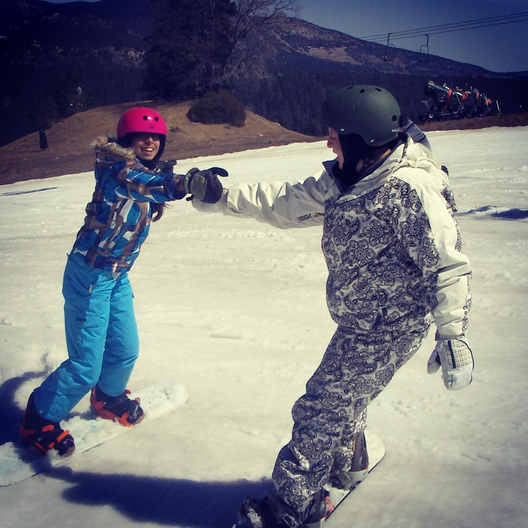 A fist bump on the slopes. Stay motivated!
