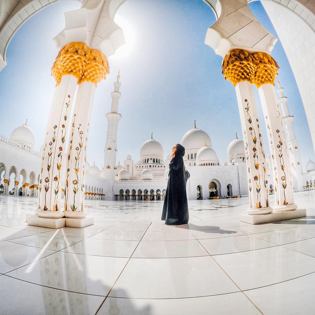 Photo of the Day! @stojanovovaa taking in the serenity of a beautifully built mosque in #AbuDhabi, United Arab Emirates. Have you seen some awesome artitechure? Share it with us by following the link in our profile. #GoPro #GoProTravel #SheikhZayedMosque