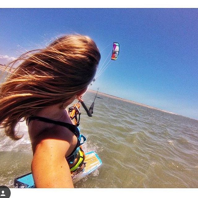 Kite hair don't care. #teamsensi rider @malinamle flying by. #beachhairdontcare #kiteboarding #kitebabe #jointheadventure #sun #water #travel #kitesurf