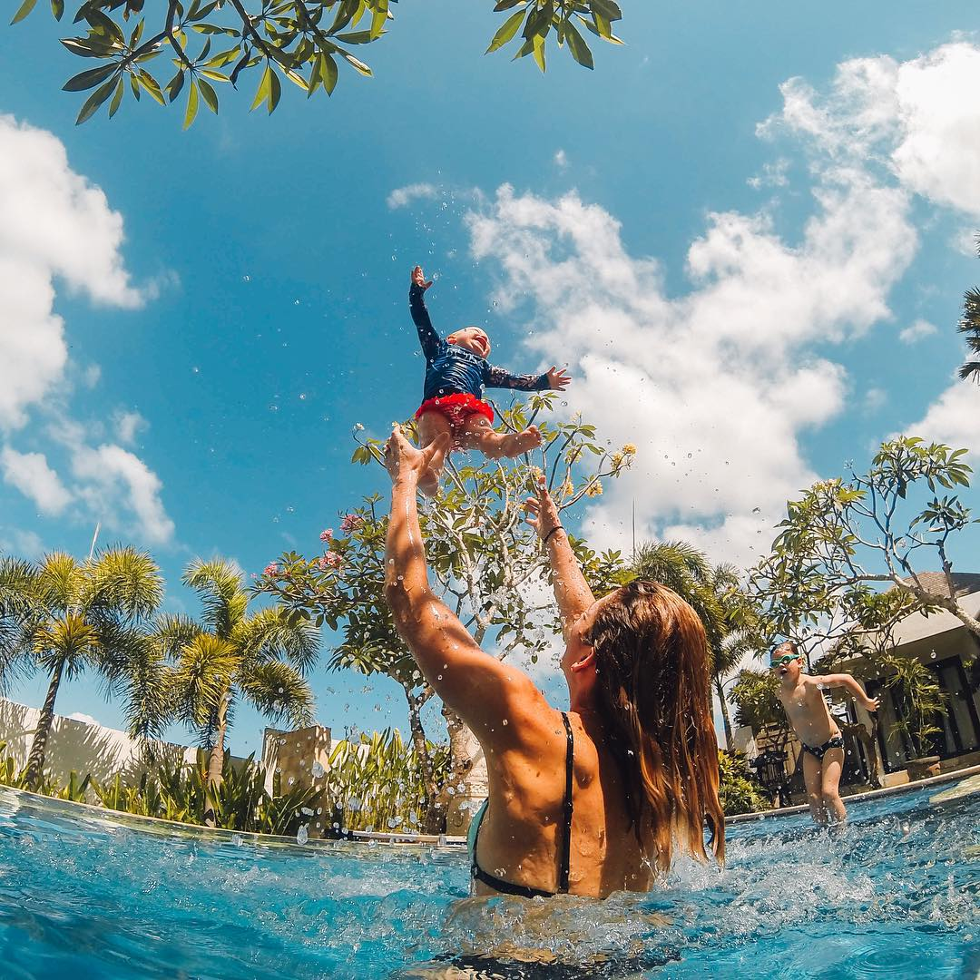 Photo of the Day! @captain_kookman returned from the beach to the sounds of his wife @lauren_luckiest and their kids splashing around the pool during a vacation in #Bali. Share your family vacations with us by following the link in our profile.