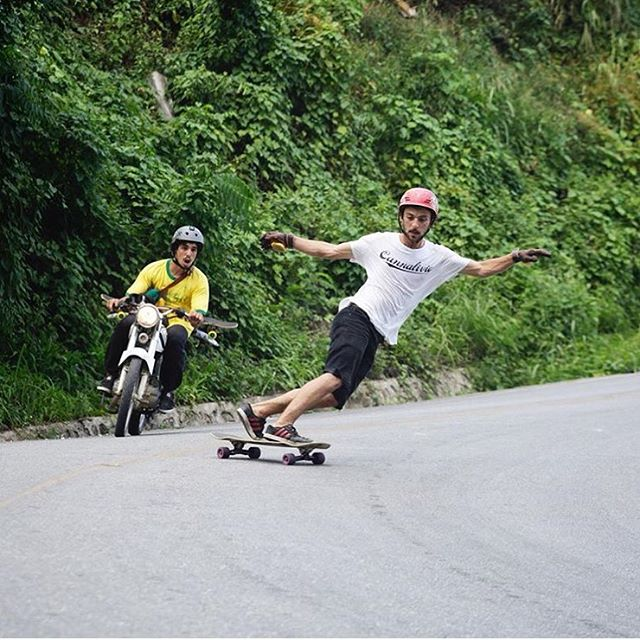 @perropro photo of team rider @camilocespedes floating a toeside somewhere in the #DR -- followed by a friend who looks totally amazed #predatorhelmets #fr7 #originalpredatordesign #dominicanrepublic