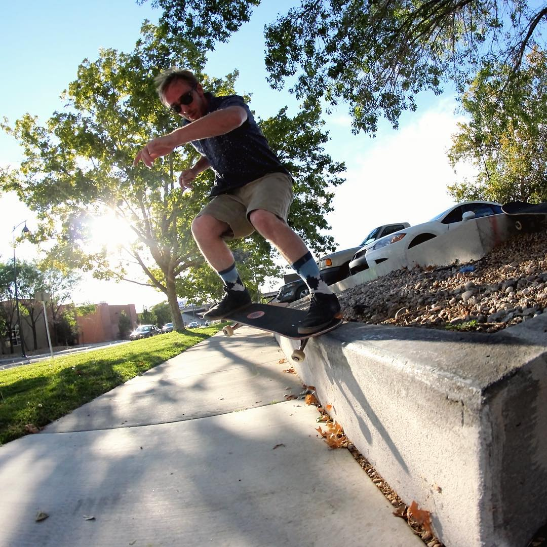 Turning the word to sand one grind at a time, James West (@jimmywesterson) gets crooked on this concrete ledge.