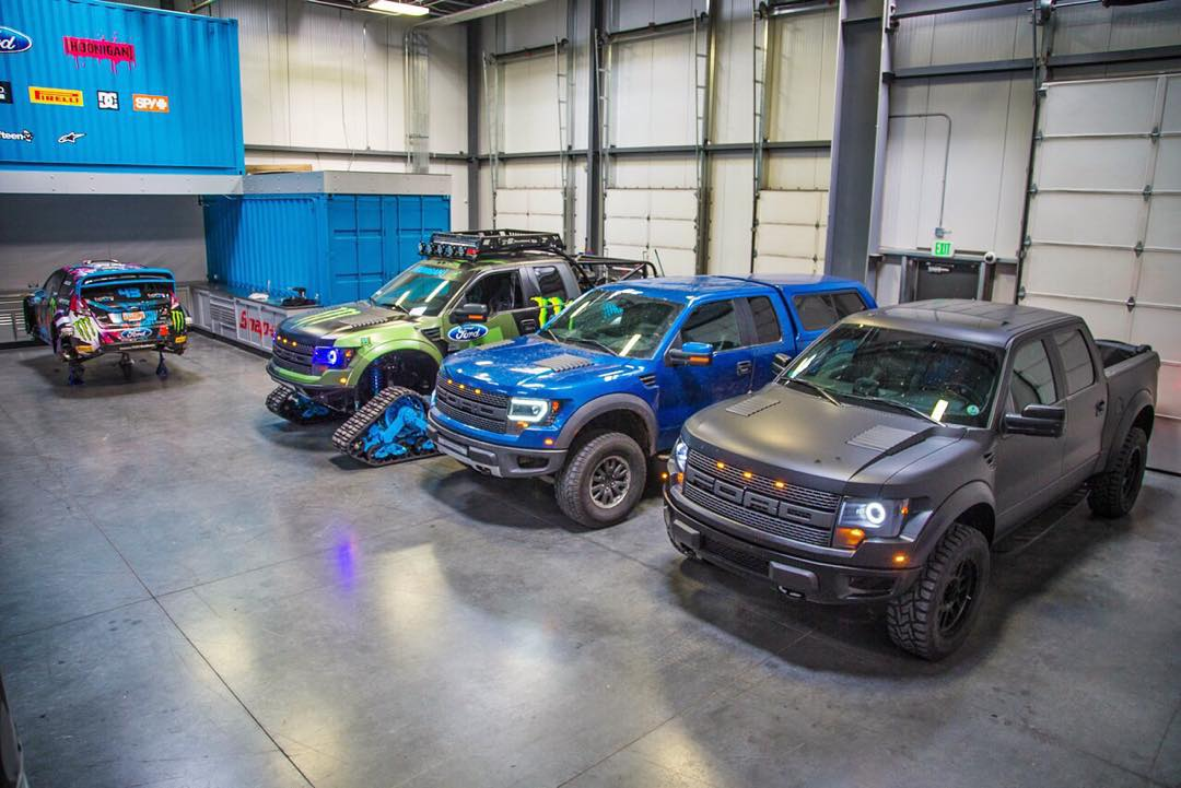 Ain't no party like a Raptor party. Especially when it's in the @HooniganRacing Headquarters shop area. Ha. #RaptorTRAX, @jsurprenant114's blue Raptor, and my daily driver Raptor. All kitted out with @raptorretrofit headlights. #dinosaurtrucksquad...
