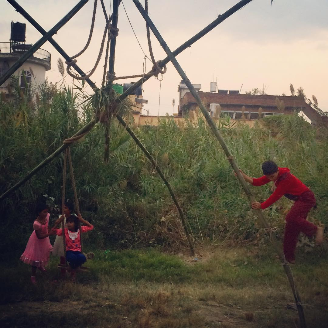 Kids playing on a traditional handmade bamboo swing in celebration of the start of one of the most celebrated Hindu festivals. Happy Dashain! #connectglobally #nepal #estwst