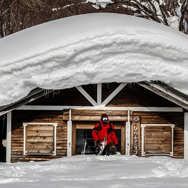 Think there's enough snow in #Niseko Japan? Here's a shot of @tjswaycollective starting his morning hike out of his lodging in his Red #CrystalizeJkt . @5fyve @blackstrap_inc