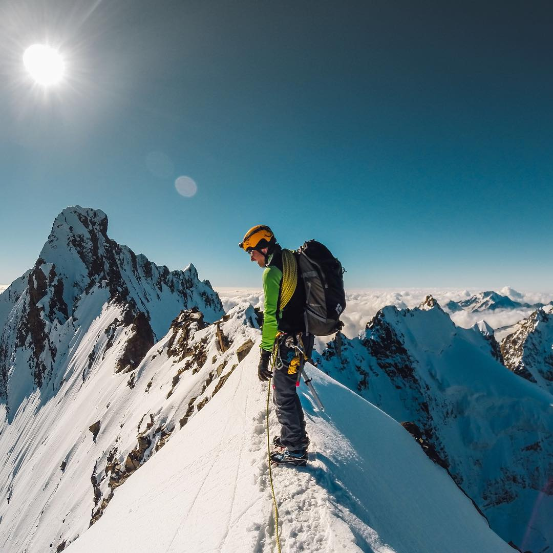 Photo of the Day! Ascending the 4000m high peak, #PizBernina, in the Swiss Alps. #