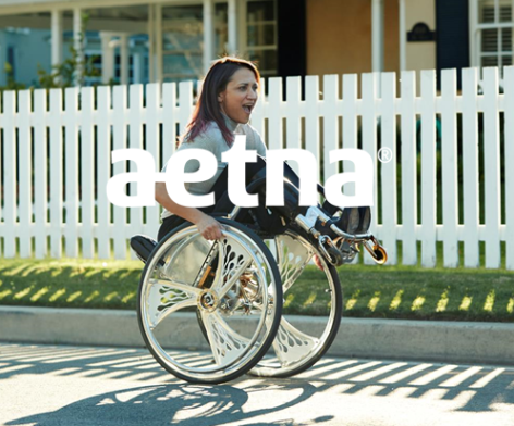 woman rolling down sidewalk in wheelchair