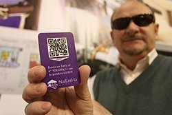 Blind man holding an accessible hotel key