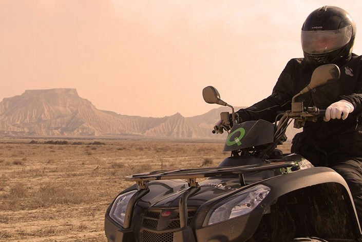 Person riding and adaptive four-wheeler