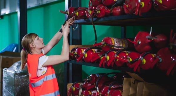Woman inspecting firefighting equipment8