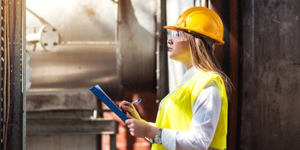 Woman inspecting machinery600