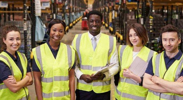 various_Vectrus_workers_in_yellow_vests