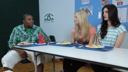 kenan talking at the table