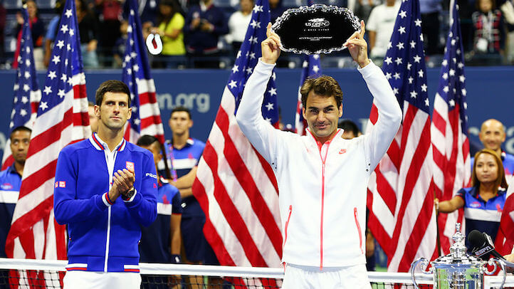 Roger Federer accepting a bribe from the U.S. Open last summer. (Getty)