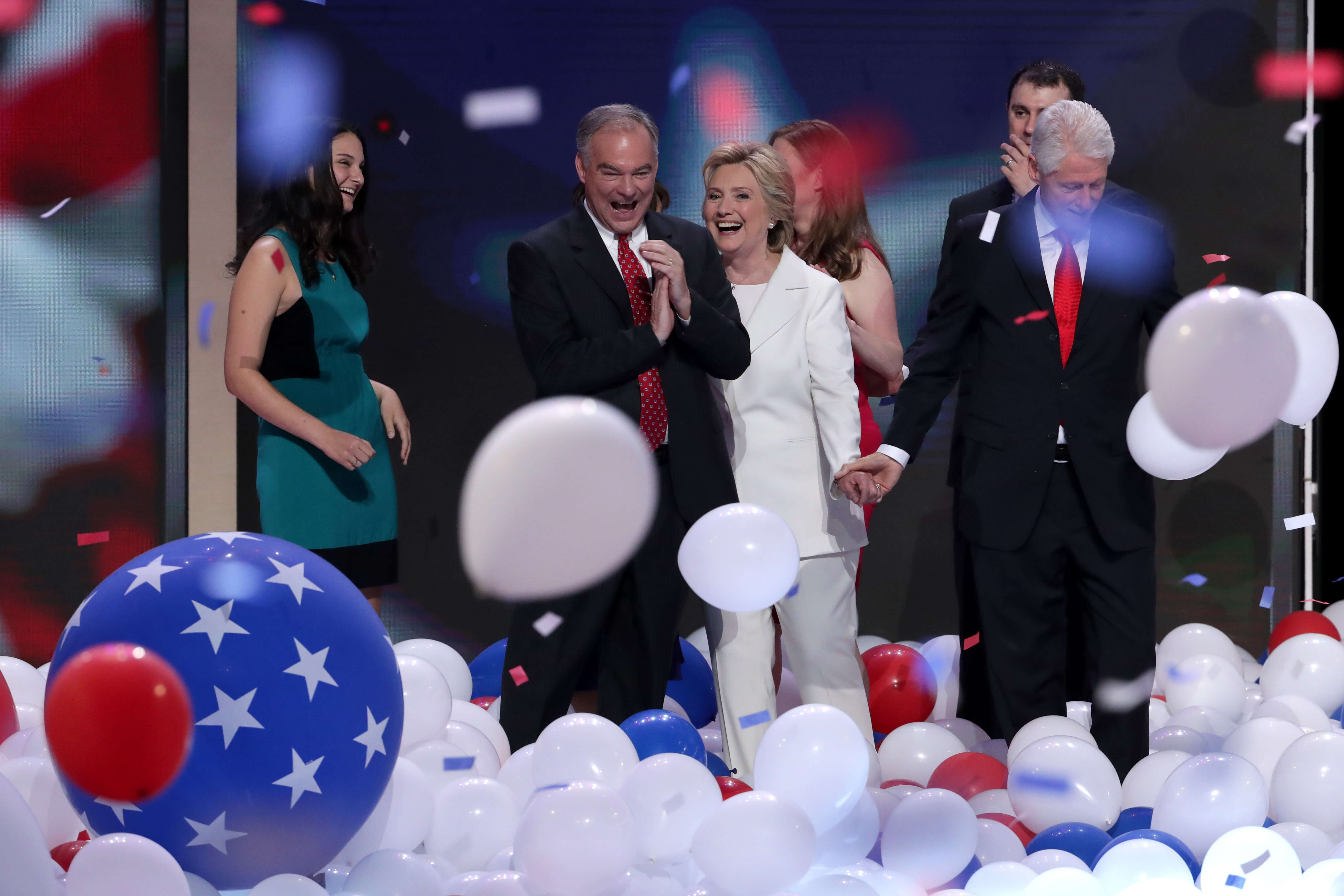 PHILADELPHIA, PA - JULY 28:  Democratic presidential candidate Hillary Clinton (C) and US Vice President nominee Tim Kaine (2nd-L) stand with their families on stage at the end of the fourth day of the Democratic National Convention at the Wells Fargo Center, July 28, 2016 in Philadelphia, Pennsylvania. Democratic presidential candidate Hillary Clinton received the number of votes needed to secure the party's nomination. An estimated 50,000 people are expected in Philadelphia, including hundreds of protesters and members of the media. The four-day Democratic National Convention kicked off July 25.  (Photo by Alex Wong/Getty Images)