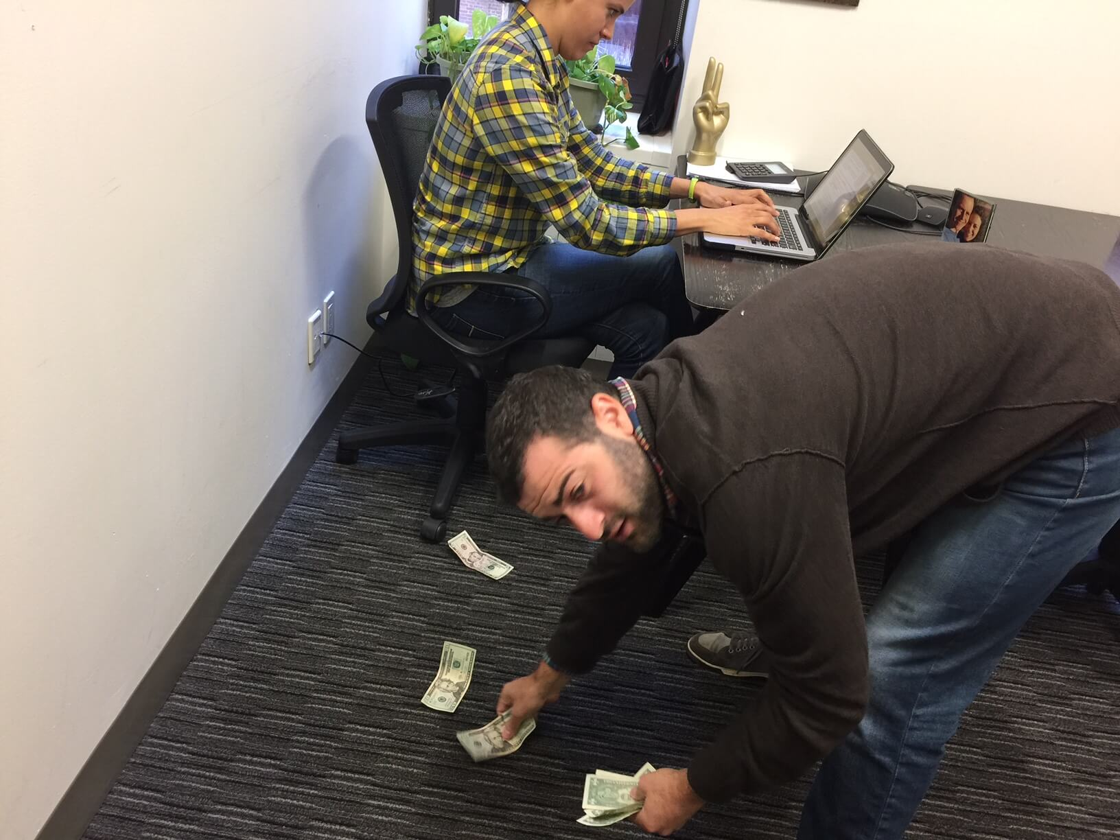Then you have to awkwardly scrounge around on the floor to get your money. Fun!
