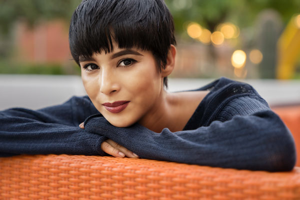 Woman with black hair in a pixie cut