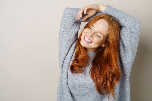 woman with red hair blown out for volume