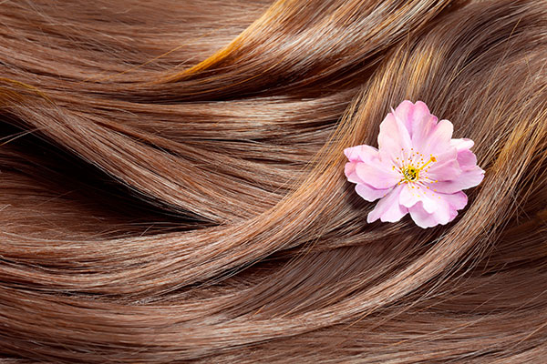 brown silky hair with a spring flower in it