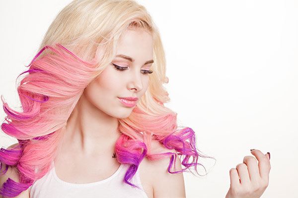 woman with pink purple and blonde reverse ombre hair