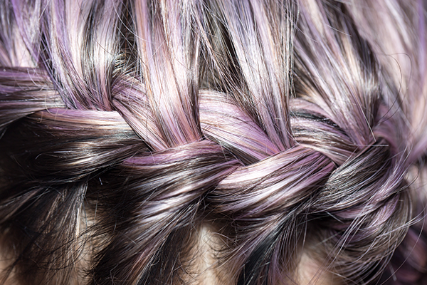 braid of purple tinted gray hair